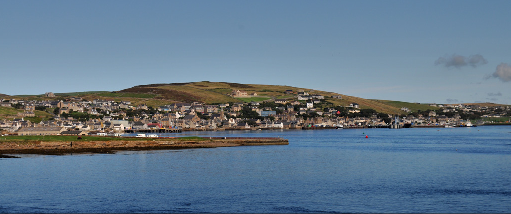 A photograph of Stromess - looking back from the ferry MV Hamnavoe towards Stromness Harbour, Mainland Orkney, Scotland.